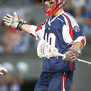 Stephen Berger #10 of the Boston Cannons celebrates a goal during the game at Harvard Stadium on August 9, 2014 in Boston, Massachusetts. (Photo by Elan Kawesch)