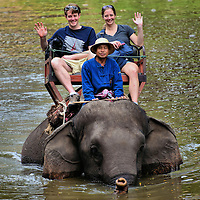 Tourists Riding Elephant in Water in Hang Chat, Thailand<br />