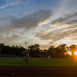 A runner during a one team 4 x 100 meter relay race during a all comers track event sponsored by the New Orleans Club held at St Martin's Episcopal  in Metairie, La. Friday, July 7, 2017.