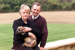 Longparish, near Andover. Richard Faulds got a gold medal in the shooting at the olympics. He lives in Longparish.  Richards Parents, Sue and Bruce with Richard's 5 month old puppy Sydney, September 29, 2000. Photo by Andrew Parsons / i-Images..