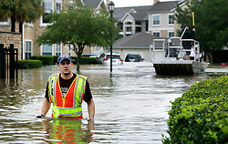 August 29, 2017 - Houston, Texas, U.S. - JOHN KAUFFMAN, a volunteer rescue worker from San Antonio checks for stranded residents at apartments in Kelliwood subdivision in Houston, as other boats search, on Tuesday. (Credit Image: © Bob Owen/San Antonio Express-News via ZUMA Wire)