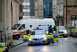 © Licensed to London News Pictures.  25/02/2015. Bristol, UK.  A prison van with an armed police escort arrives at Bristol Crown Court.  It is the first day of the trial of Kevin Brown who is accused of trying to rob a security van in Bristol as it was parked outside a row of shops when a man armed with a gun tried to force his way into the Post Office van.  The 55-year-old is also charged with possession of a firearm with intent to cause fear of violence and dangerous driving on June 12 last year.  Brown was arrested at the Lansdown pub in Clifton in Bristol two days later.  He is also alleged to have absconded from Ford Open Prison in Sussex two months before the van attack. Photo credit : Simon Chapman/LNP