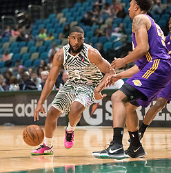 March 29, 2017 - Reno, Nevada, U.S - Reno Bighorn Guard PEÃ•SHON HOWARD (5) drives against Los Angeles D-Fender Forward JUSTIN HARPER (23) during the NBA D-League Basketball game between the Reno Bighorns and the Los Angeles D-Fenders at the Reno Events Center in Reno, Nevada. (Credit Image: © Jeff Mulvihill via ZUMA Wire)