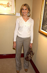 OLIVIA NEWTON-JOHN at a private view of paintings by singer Tony Bennett held at the catto Gallery, 100 Heath Street, London NW3 on 5th April 2005.<br />