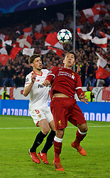 SEVILLE, SPAIN - Tuesday, November 21, 2017: Liverpool's Roberto Firmino and 's Clément Lenglet during the UEFA Champions League Group E match between Sevilla FC and Liverpool FC at the Estadio Ramón Sánchez Pizjuán. (Pic by David Rawcliffe/Propaganda)