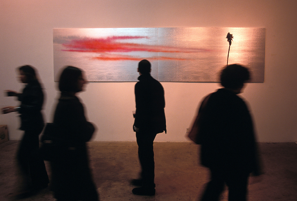 Patrons observe art in Chinatown section of Los Angeles, CA, Nov, 2002.