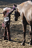 Middletown, NY - A young girl pets her horse at the Middletown Rotary Horse Show at Fancher Davidge Park on Sept. 16, 2007.