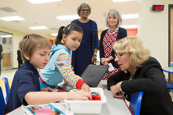 April 3, 2017 - Fort Bragg, NC, United States of America - U.S. Secretary of Education Betsy DeVos speaks with children during a visit to the Kimberly Hampton Primary School at Fort Bragg Army base April 3, 2017 in Fayetteville, North Carolina. DeVos, during the visit said military families should be able to use federal vouchers to attend schools they choose. (Credit Image: © Simon Edelman/Planet Pix via ZUMA Wire)