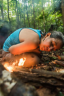 Manaus, Amazonia, Brazil, November 2018.  Building shelter and making fire in the jungle while exploring the Amazone Rainforest with Leo and Vanessa of Amazon Emotions. The Amazone river and Rio Negro connect the small rain forest communities that dot the region. River Amazon (Portuguese: Rio Amazonas; Spanish: Río Amazonas) of South America is the largest river in the world by volume, with total river flow greater than all the other top ten largest rivers flowing into the ocean combined. The Amazon drains an area of some 6,915,000 square kilometres (2,670,000 sq mi), or some 40 percent of South America. Photo by Frits Meyst / MeystPhoto.com
