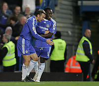 Photo: Lee Earle.<br /> Chelsea v Watford. The Barclays Premiership. 11/11/2006. Chelsea's Michael Essien (R) celebrates with Andriy Shevchnko after he scored their third.