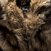 Mens Raccoon fur coat on a black background.