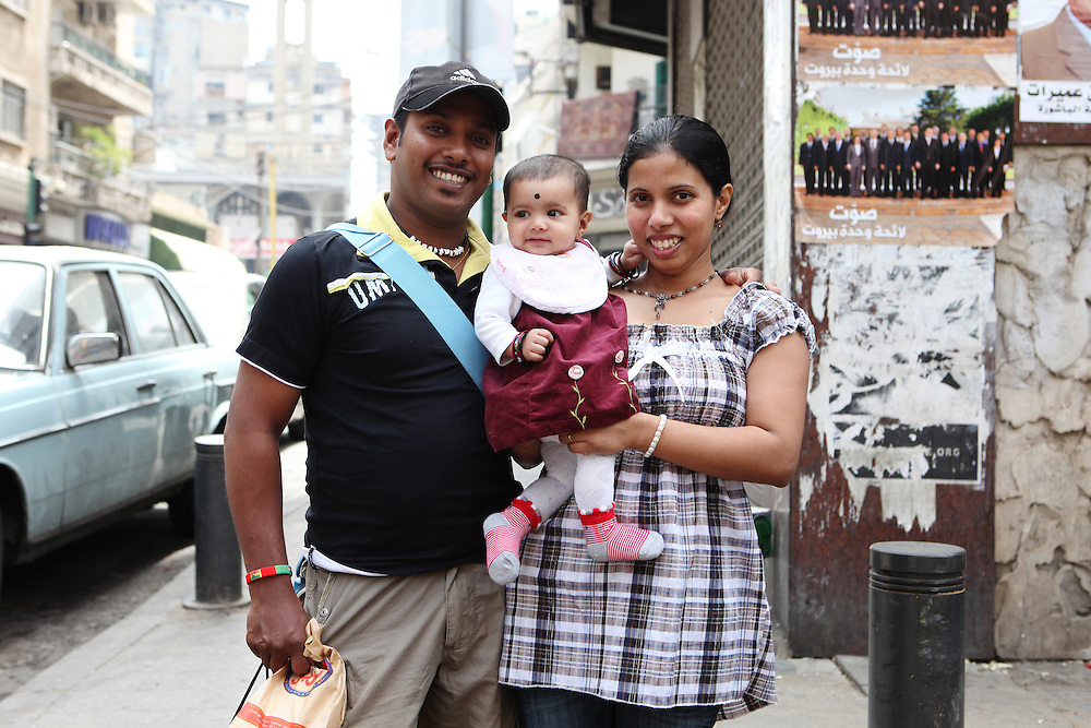 A Sri Lankan family enjoys their day off with their newborn daughter.