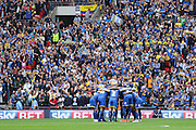 Players huddle before the Sky Bet League 2 play off final match between AFC Wimbledon and Plymouth Argyle at Wembley Stadium, London, England on 30 May 2016. Photo by Stuart Butcher.