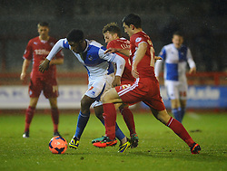 Bristol Rovers' Ellis Harrison holds off two Crawley players - Photo mandatory by-line: Seb Daly/JMP - Tel: Mobile: 07966 386802 18/12/2013 - SPORT - FOOTBALL - Broadfield Stadium - Crawley - Crawley Town v Bristol Rovers - FA Cup - Replay