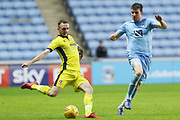 Carl Winchester and  Chris Stokes during the EFL Sky Bet League 2 match between Coventry City and Cheltenham Town at the Ricoh Arena, Coventry, England on 16 December 2017. Photo by Antony Thompson.