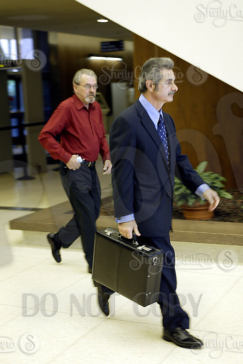 Nov 15, 2004; Santa Ana, CA, USA; Attorney PETE SCALISI arrives with an uncle (red) at the Santa Ana Superior Court House in Orange County for a bail hearing for 19 year old Greg Haidl, son of former assistant sheriff Don Haidl. Greg Haidl was voluntarily absent from the court hearing due to his exhausted emotional condition and treatment for depression per doctor reccomendation. Legal counsel was denied a continuance on the hearing. Mandatory Credit: Photo by Shelly Castellano/ZUMA Press. (©) Copyright 2004 by Shelly Castellano