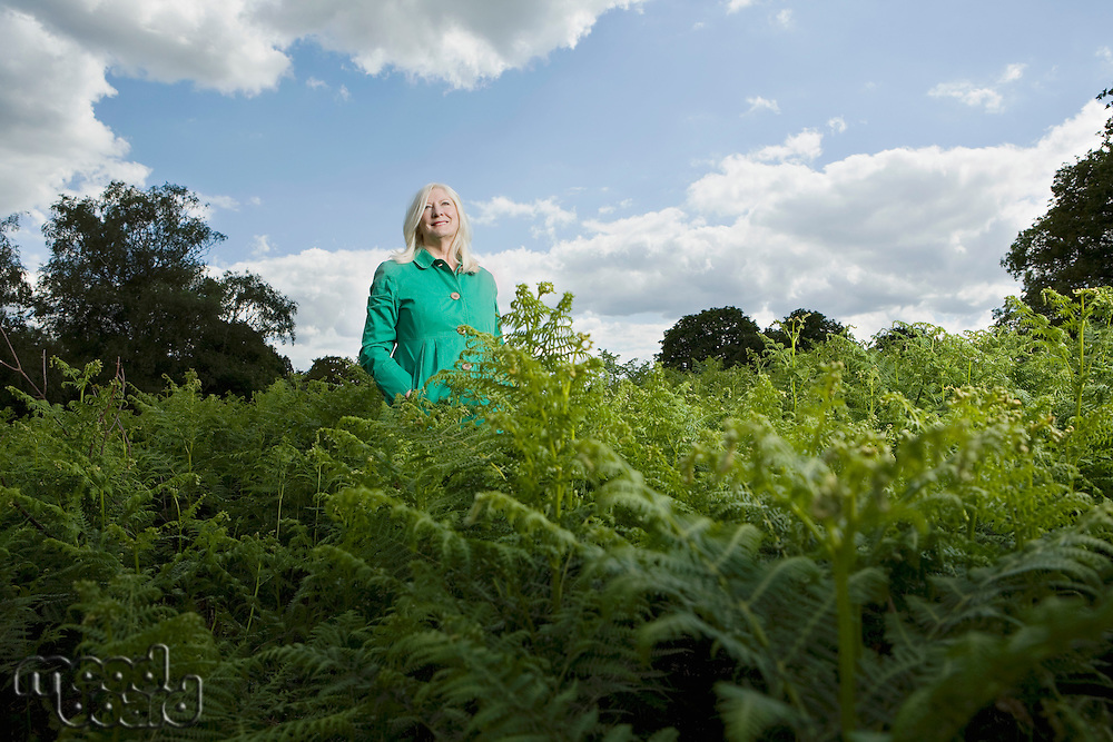 Woman Standing Among Ferns
