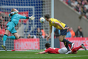 Callum O'Dowda (Oxford United) heads past Adam Davies (Barnsley) to open the scoring, 1-0 to Oxford during the Johnstone's Paint Trophy Final between Barnsley and Oxford United at Wembley Stadium, London, England on 3 April 2016. Photo by Mark P Doherty.