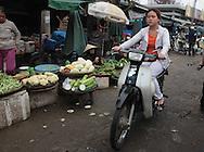 A market scene in Hue, Vietnam, Photograph by Dennis Brack
