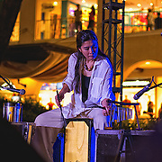 Percussionist Toni Bernardo during the opening night performance of the 2014 Philippine International Jazz Festival at the Alabang Town Center venue with Mishka Adams.