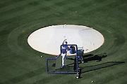 LOS ANGELES, CA - AUGUST 22:  Overhead general view of a pitcher throwing baseballs during batting practice before the Los Angeles Dodgers game against the New York Mets at Dodger Stadium on Friday, August 22, 2014 in Los Angeles, California. The Dodgers won the game 6-2. (Photo by Paul Spinelli/MLB Photos via Getty Images)