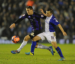 Bristol Rovers' Eliot Richards battles for the ball with Birmingham City's Paul Caddis - Photo mandatory by-line: Joe Meredith/JMP - Tel: Mobile: 07966 386802 14/01/2014 - SPORT - FOOTBALL - St Andrew's Stadium - Birmingham - Birmingham City v Bristol Rovers - FA Cup - Third Round