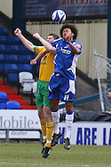 Oldham - Saturday February 26th, 2010 :  Michael Nelson of Norwich and Jason Price of Oldham in action during the Coca Cola League One match at Boundary Park, Oldham. (Pic by Paul Chesterton/Focus Images)..