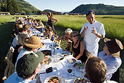 PRICE CHAMBERS / NEWS&amp;GUIDE<br /> Outstanding in the Field visits the Mead Ranch in Spring Gulch on Thursday, July 22, 2010. Snake River Grill Chef Jeff Drew coordinates a gourmet, five-course meal enjoyed by the guests at a long table set in the ranch field. Pam Niner of Niner Wine Estates provides some of their latest favorites.