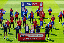 (Free to use courtesy of Sky Bet) Swindon Town gather at The County Ground to celebrate becoming Sky Bet League Two Champions, with a socially distanced trophy lift, after the curtailment of the regular season due to the Covid-19 pandemic - Rogan/JMP - 26/06/2020 - The County Ground - Swindon, England - Sky Bet League 2.