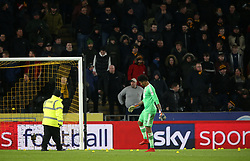 Sheffield United goalkeeper Jamal Blackman helps stewards clear away tennis balls that were thrown onto the pitch in protest at the Hull City owners