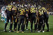 The Pittsburgh Steelers offense huddles and calls a play during the NFL week 10 regular season football game against the Carolina Panthers on Thursday, Nov. 8, 2018 in Pittsburgh. The Steelers won the game 52-21. (©Paul Anthony Spinelli)