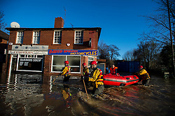 © Licensed to London News Pictures. 27/12/2015. York, UK.  An woman being rescued from her home by Mountain Rescue on Huntington Road in central York. Large areas of the North of England have been hit by severe flooding following unusually heavy rainfall in December. Photo credit: Ben Cawthra/LNP