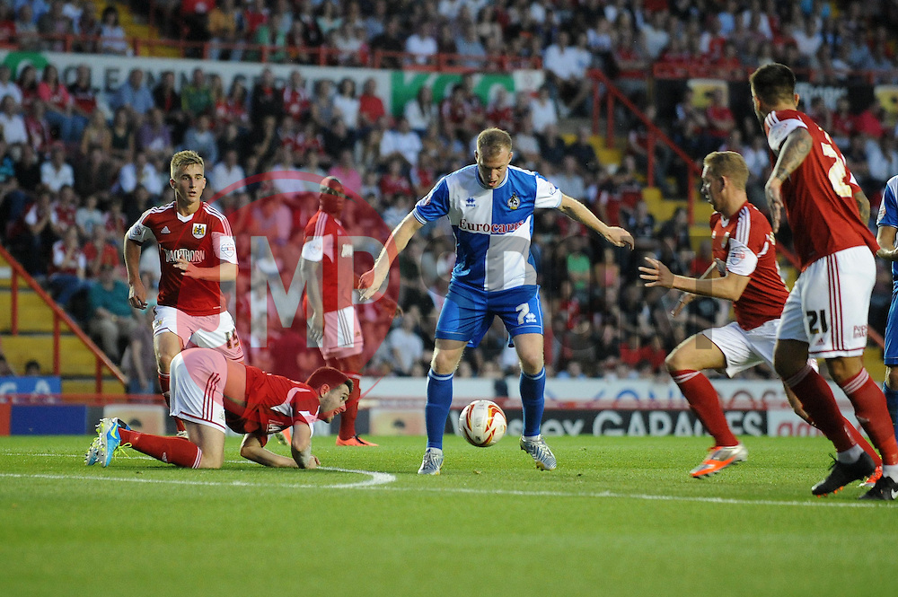 Bristol Rovers' David Clarkson finds himself surrounded by Bristol City players - Photo mandatory by-line: Dougie Allward/JMP - Tel: Mobile: 07966 386802 04/09/2013 - SPORT - FOOTBALL -  Ashton Gate - Bristol - Bristol City V Bristol Rovers - Johnstone Paint Trophy - First Round - Bristol Derby