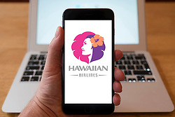 Using iPhone smartphone to display logo of Hawaiian Airlines