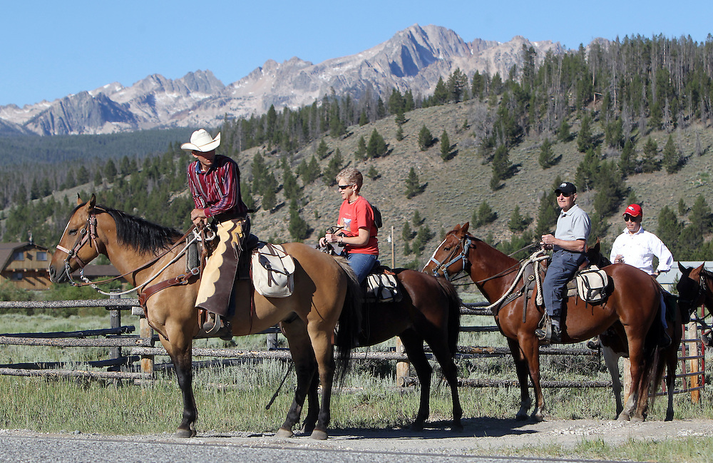 Guests at the Idaho Rocky Mountain Ranch take a guided horseback tour from Pioneer Outfitters in the Sawtooth Mountains near the town of Stanley, ID on Sunday July 14, 2013.