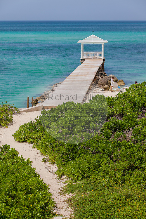 A walkway to a dock and gazebo with the ocean in Nassau, Bahamas.