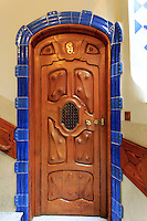 An elaborately carved door inside Casa Battlo in downtown Barcelona, Spain, one of Antoni Gaudi's most famous buildings.