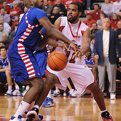 Jan 31, 2009; Piscataway, NJ, USA; Rutgers guard/forward Earl Pettis (11) passes in the paint to teammate forward Gregory Echenique (not pictured) during the first half of Rutgers' 75-56 victory over DePaul in NCAA college basketball at the Louis Brown Athletic Center