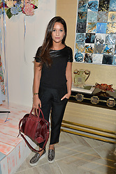 ROXIE NAFOUSI at a party to celebrate the launch of Baar & Bass, 336 Kings Road, London on 9th September 2014.
