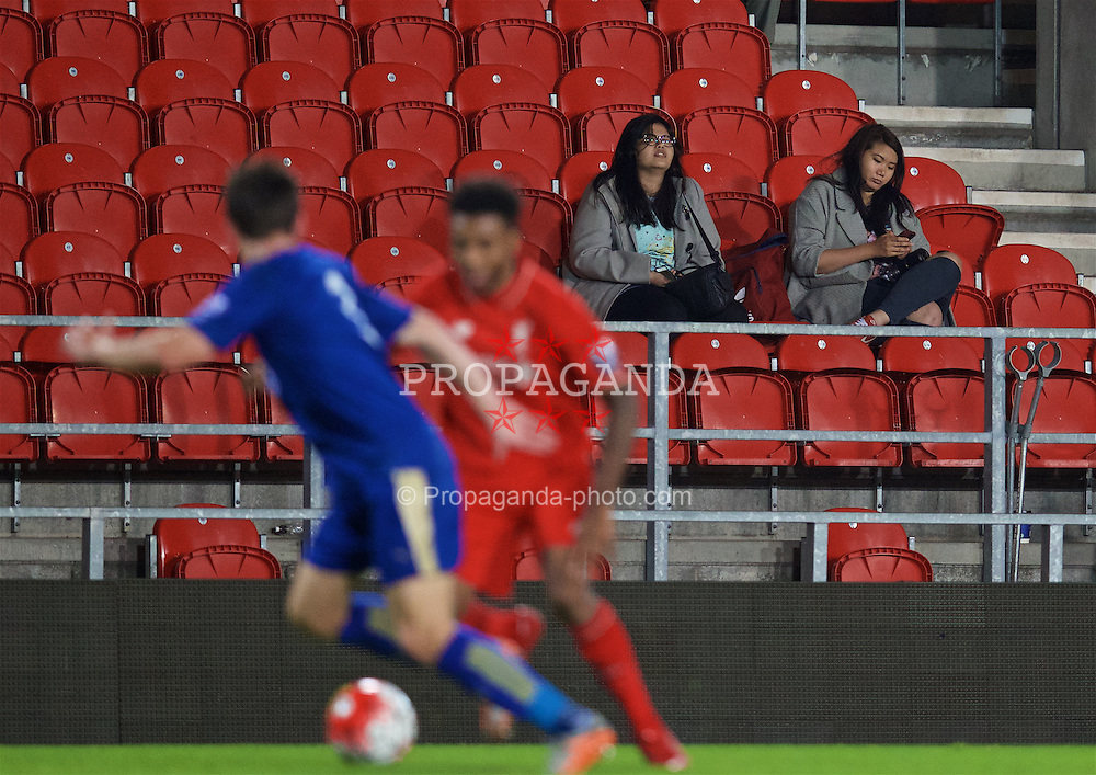 ST HELENS, ENGLAND - Monday, September 28, 2015: Liverpool supporters look disinterested during the Under 21 FA Premier League match against Leicester City at Langtree Park. (Pic by David Rawcliffe/Propaganda)