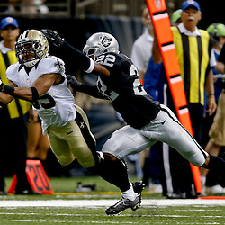 Aug 16, 2013; New Orleans, LA, USA; New Orleans Saints wide receiver Steve Breaston (85) drops the ball after getting past Oakland Raiders defensive back Taiwan Jones (22) during the second half of a preseason game at the Mercedes-Benz Superdome. The Saints defeated the Raiders 28-20. Mandatory Credit: Derick E. Hingle-USA TODAY Sports