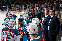 KELOWNA, CANADA - FEBRUARY 12: Referee Mike Campbell speaks to Kelowna Rockets' coaches at the bench against the Victoria Royals  on February 12, 2018 at Prospera Place in Kelowna, British Columbia, Canada.  (Photo by Marissa Baecker/Shoot the Breeze)  *** Local Caption ***