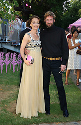 KRISTIN SCOTT THOMAS and STEFANO PILATI at the Serpentine Gallery Summer party sponsored by Yves Saint Laurent held at the Serpentine Gallery, Kensington Gardens, London W2 on 11th July 2006.<br />