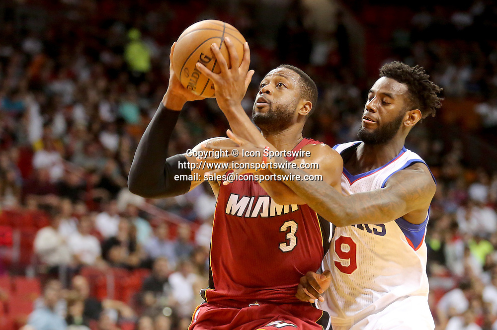 Dec. 23, 2014 - Miami, FL - Florida, USA - United States - fl-heat-76ers-1223e - Dwyane Wade of the Miami Heat is fouled as goes up for a basket against JaKarr Simpson of the Philadelphia 76ers.