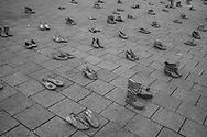 BELGIUM, Brussels. 24/11/2019: Shoes symbolising women killed by 'feminicide' while more than 10000 people protest against violence perpetrated towards women and 'feminicide'.