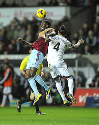 West Ham United's Carlton Cole battles for the high ball with Swansea City's Chico - Photo mandatory by-line: Joe Meredith/JMP - Tel: Mobile: 07966 386802 27/10/2013 - SPORT - FOOTBALL - Liberty Stadium - Swansea - Swansea City v West Ham United - Barclays Premier League