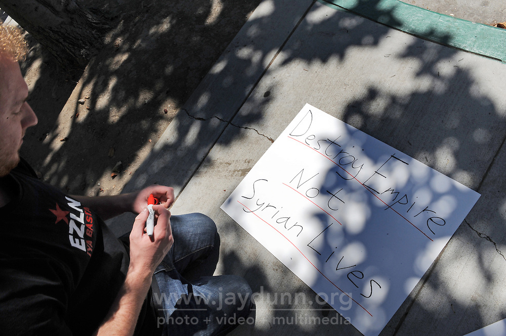 A student participates in Wednesday's protest against war in Syria organized by the Peace Coalition of Monterey County in front of the main post office in Salinas. The demonstration was in support of Congressman Sam Farr's stated antiwar position.