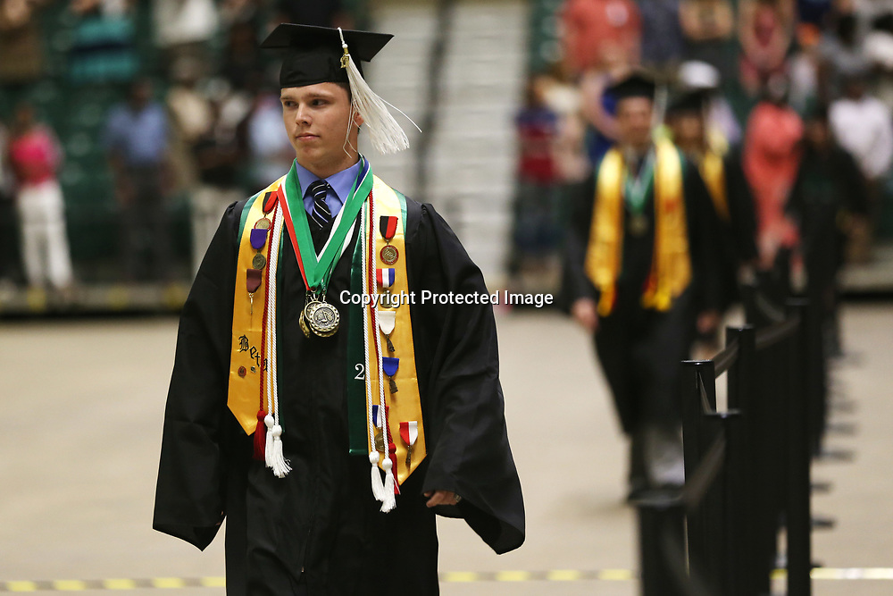 Mooreville High School senior Chris Bolton walks in with his classmates to take a seat before the start of Mooreville's graduation ceremony Saturday afternoon at the BancorpSouth Arena.