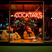 Customers wait in the bar area at Ristorante Machiavelli on Friday, Feb. 20, 2009  on Capitol Hill in Seattle.  (Joshua Trujillo / Seattle Post-Intelligencer).
