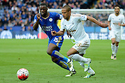 Leicester City forward Jeff Schlupp and Swansea City midfielder Wayne Routledge chase the ball during the Barclays Premier League match between Leicester City and Swansea City at the King Power Stadium, Leicester, England on 24 April 2016. Photo by Alan Franklin.